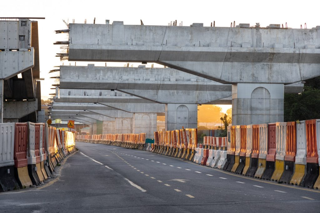 Construction of highway overpass bridge infrastructure in progress
