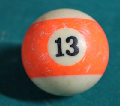 Orange snooker ball with number 13